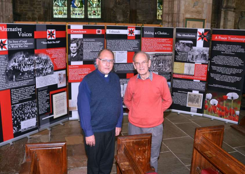 QUAKER EXHIBITION: Roger Seal (right), of Spalding Quaker Meeting, with the Rev John Bennett at St Mary and St Nicolas Church where an 'Alternative Voices' exhibition is running until November 20. Photo by Tim Wilson. SG101017-110TW.