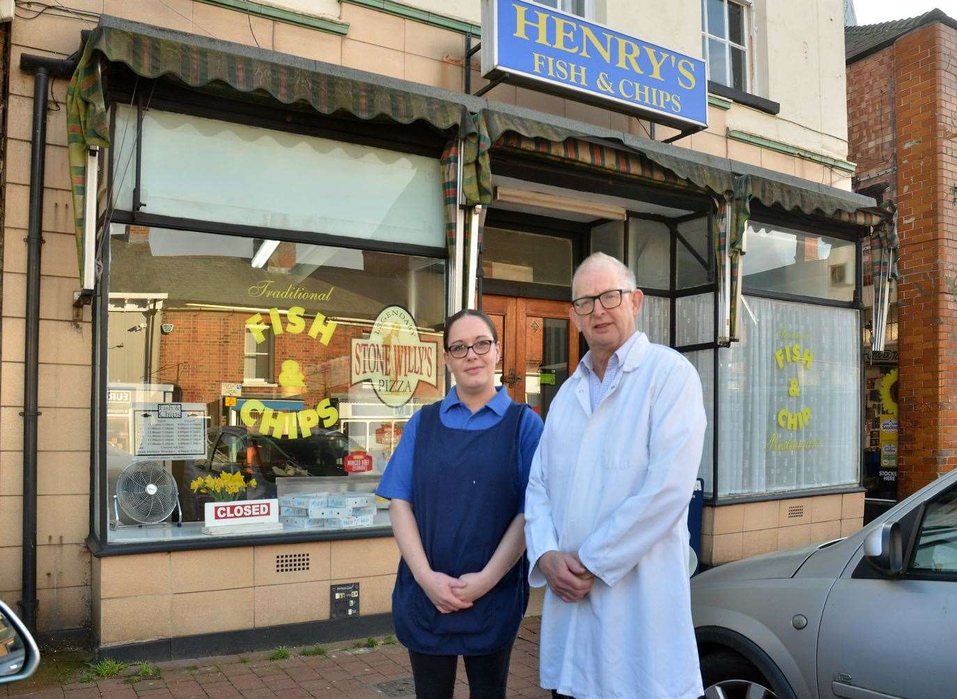 Trevor Smith and staff member Gwen outside Henry's Fish 'N' Chip Shop in Long Sutton.