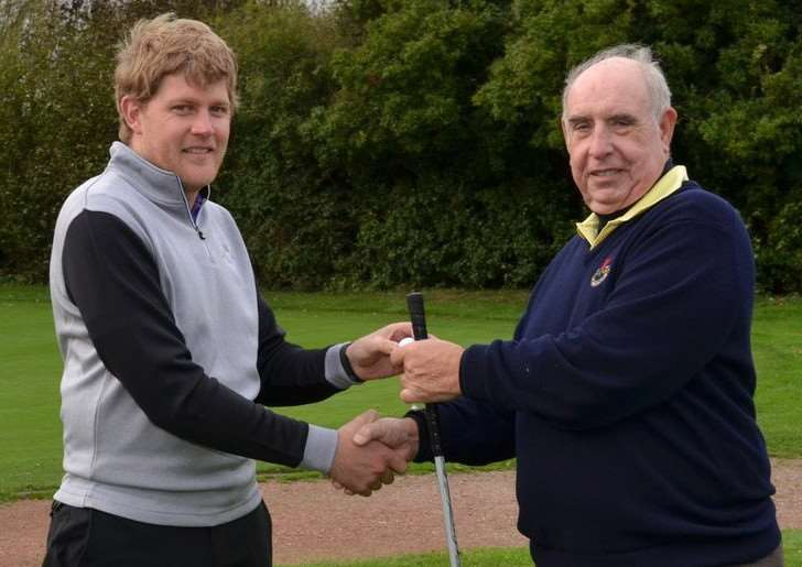 Club professional Adam Keogh handing over the customary golf ball to the new captain John Camm.