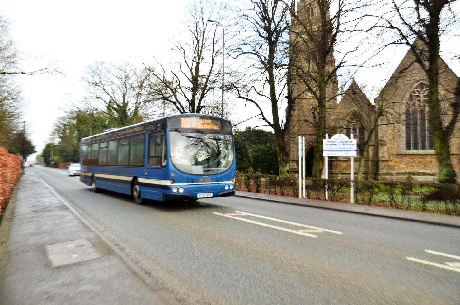 The new 203 Spalding to Stamford bus service approaches Deeping St Nicholas Parish Church. Photo (TIM WILSON): SG-250119-008TW.