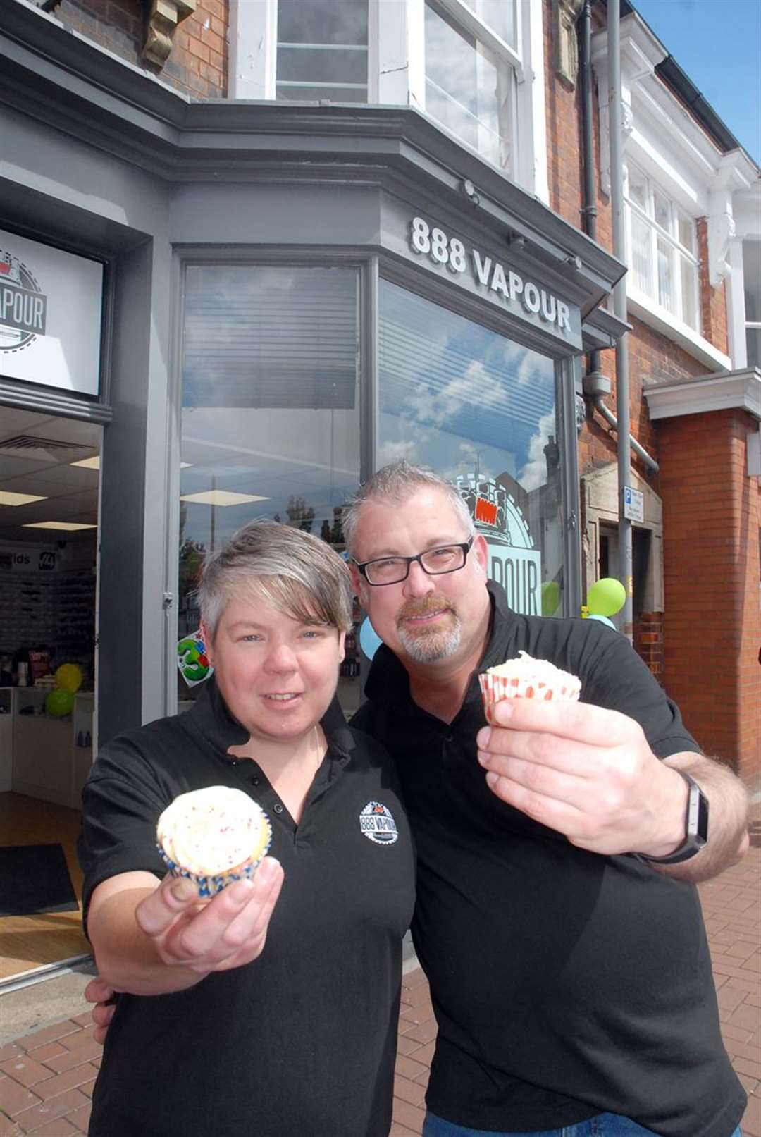Sally Grooby and Colin Wallers celebrate with cup cakes.