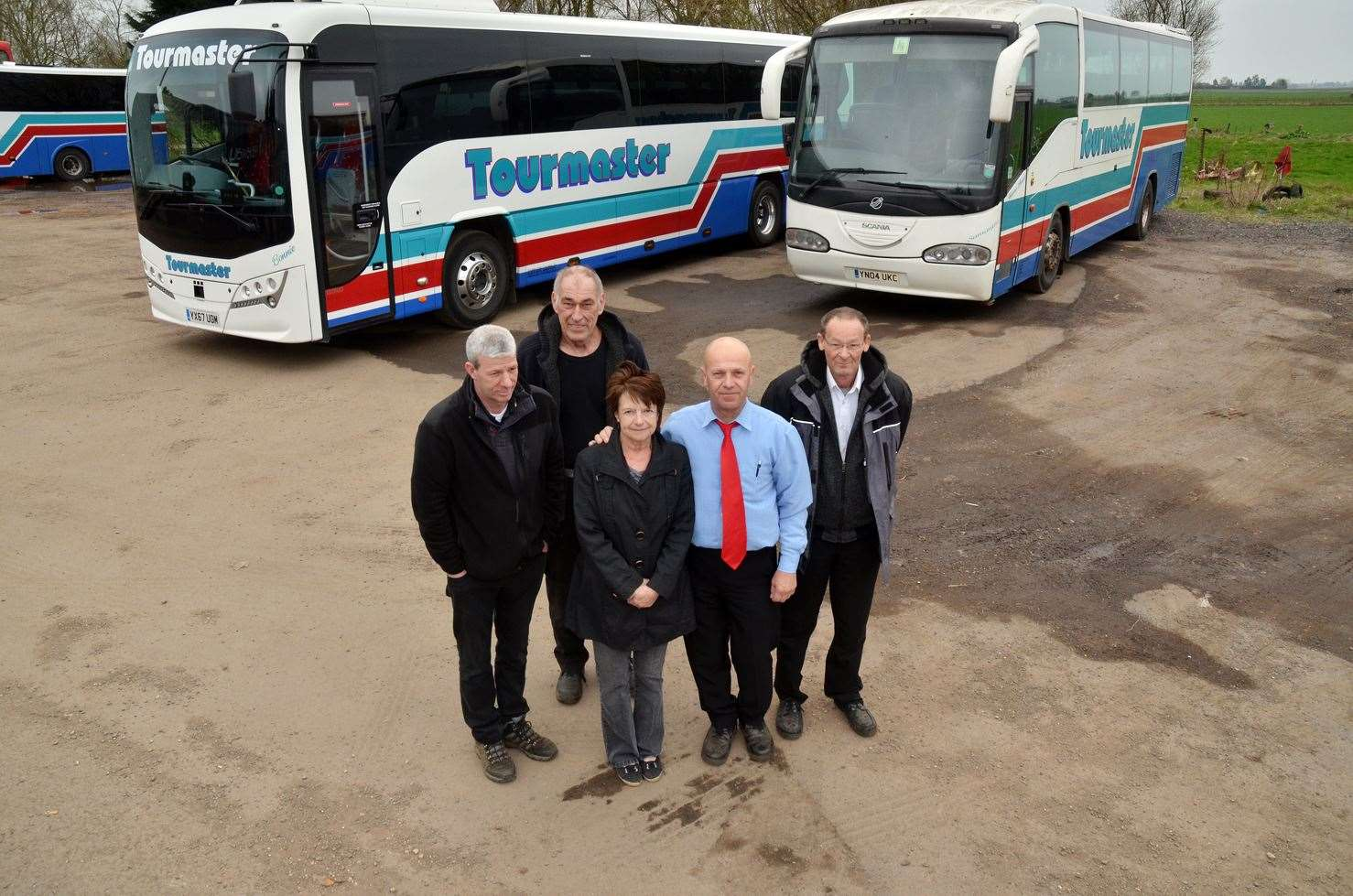LAST TRIPS: Driver Rick Marriott, mechanic Malcolm Cooper and director Terri Disney, with drivers Dobri Terziev and Terry Deane, of Tourmaster Coaches in Crowland. Photo (TIM WILSON): SG-220319-005TW