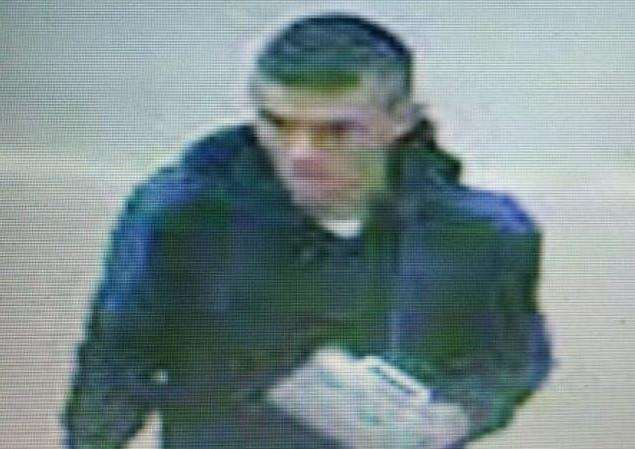 Police want to speak to this man in connection with a theft from Spalding Sainsbury's.