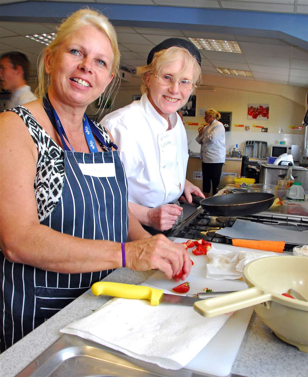 Fay Baillie (right) takes part in a cookery competition, with Jenny Thompson, for staff at Thomas Cowley High School, Donington. Photo by Tim Wilson. SG090714-135TW