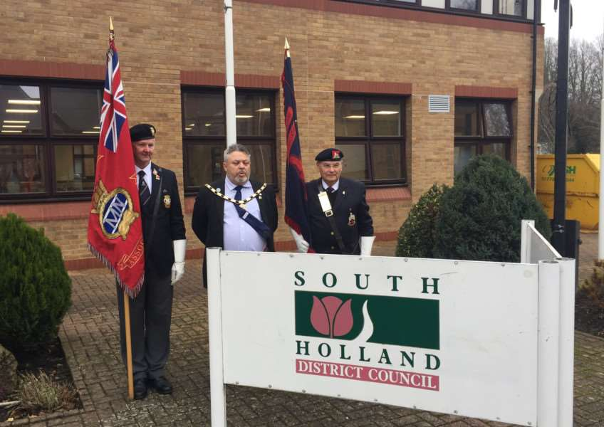 Council chairman Rodney Grocock raised the flag outside Priory Road to mark Commonwealth Day, in the presence of fellow South Holland councillors and council officers. Also pictured is National Research Officer at the Merchant Navy Association Ben Stock and Ken Willows, od the Lincolns Regiment.