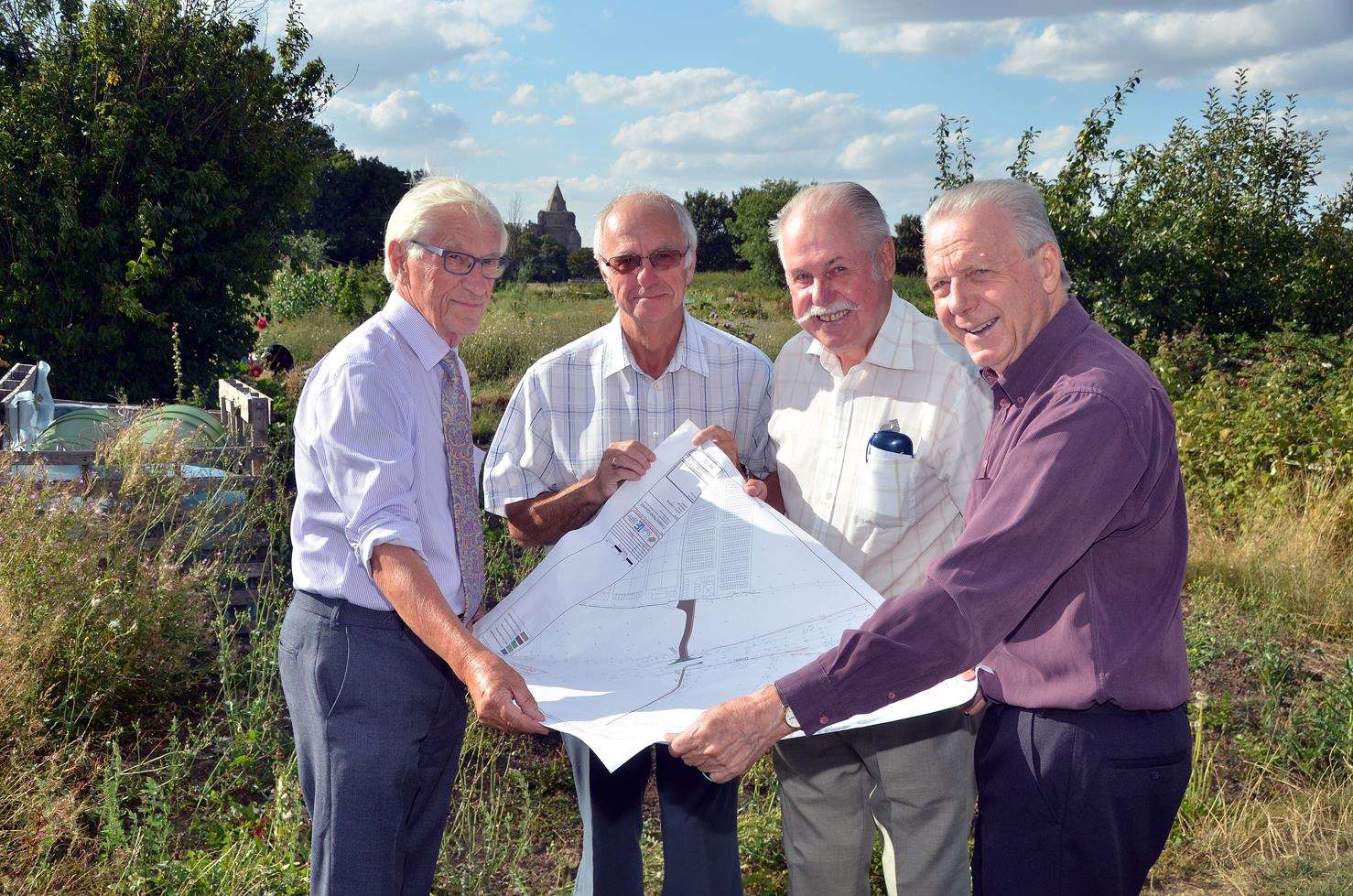 Couns Bryan Alcock, Peter Haselgrove, Reg Boot and David Ringham look at plans forCrowland's new allotments site in James Road.Photo (TIM WILSON): 020818139SG