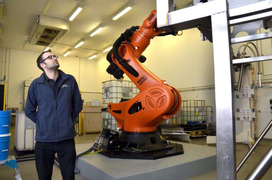 Kyle Constable with the A.P.R.I.L robot, designed to dramatically increase productivity, food safety and traceability. (SG150318-104TW)