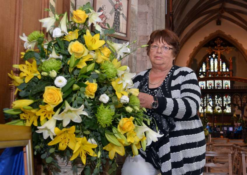 Organiser Carole Cole with one of the flower displays at Crowland Abbey. Photo by Tim Wilson. SG260817-159TW.