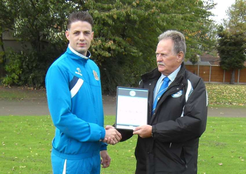 WELL DONE: Spalding United's reserve-team captain Aidan Doherty collects the sportsmanship of the month award for September from Peterborough & District League board member Dave Barfoot.