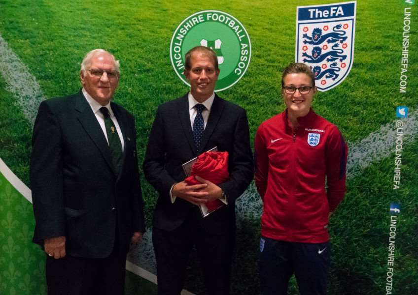 Richard Smith collects his award from Ray Tewson of Lincolnshire FA and England striker Ellen White