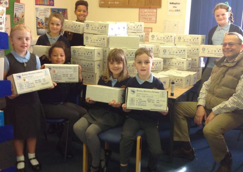 St John the Baptist School pupils present their shoeboxes to David Spenceley.
