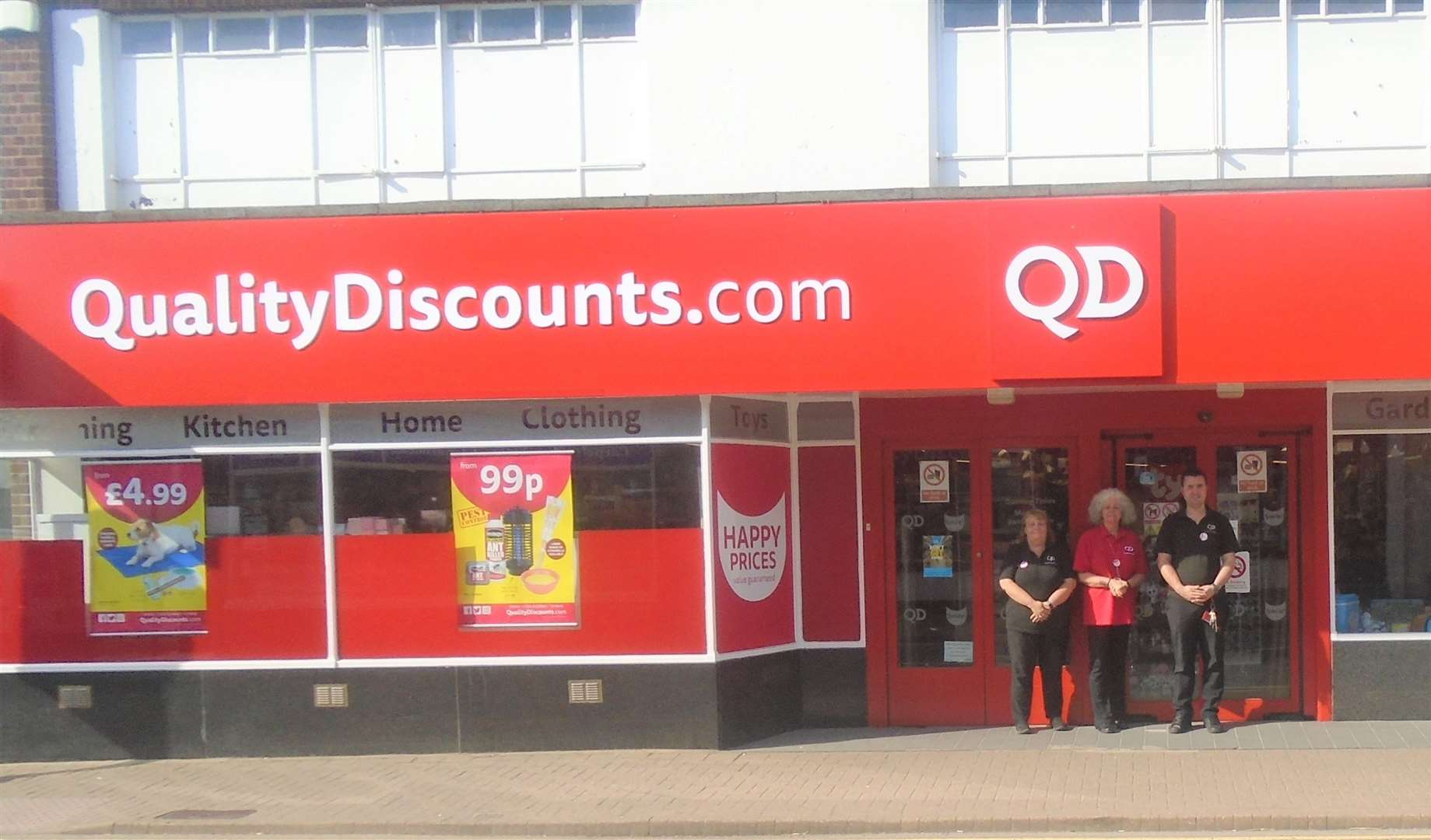 QD staff outside the refurbished store (13730793)