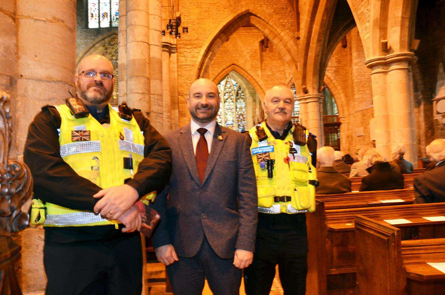 BUDGET GAP: Police and Crime Commissioner Marc Jones at a Remembrance event in Spalding, with PCSOs Paul Coupland and Colin Abbotts at St Mary and St Nicolas Church. Photo (TIM WILSON): SG-061118-004TW
