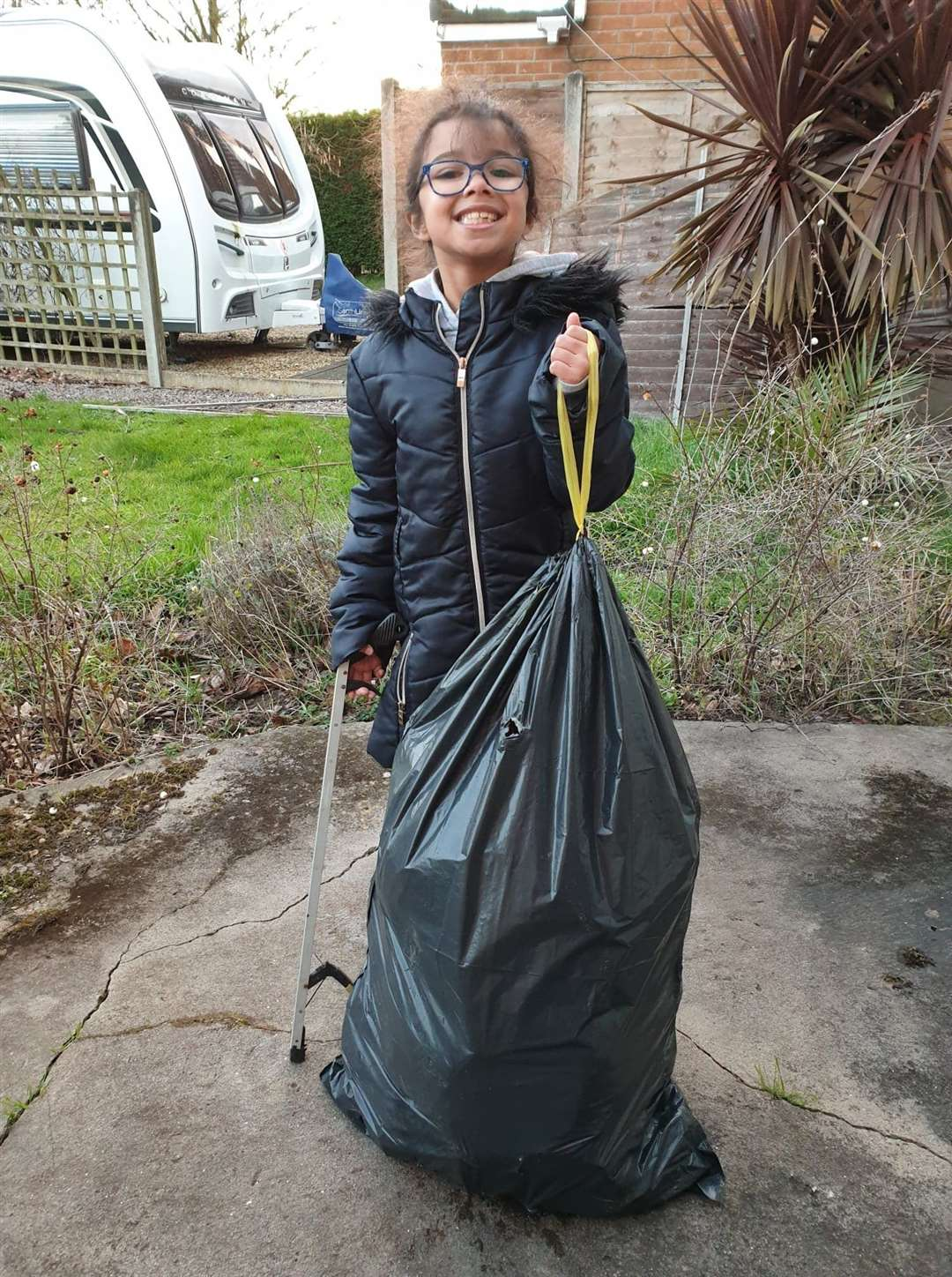 Volunteer Mya Doades has helped Denise with her litter picks in the past.
