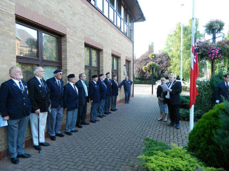 Coun Rodney Grocock addresses those present as the flag is raised outside South Holland Council's offices to mark Merchant Navy Day