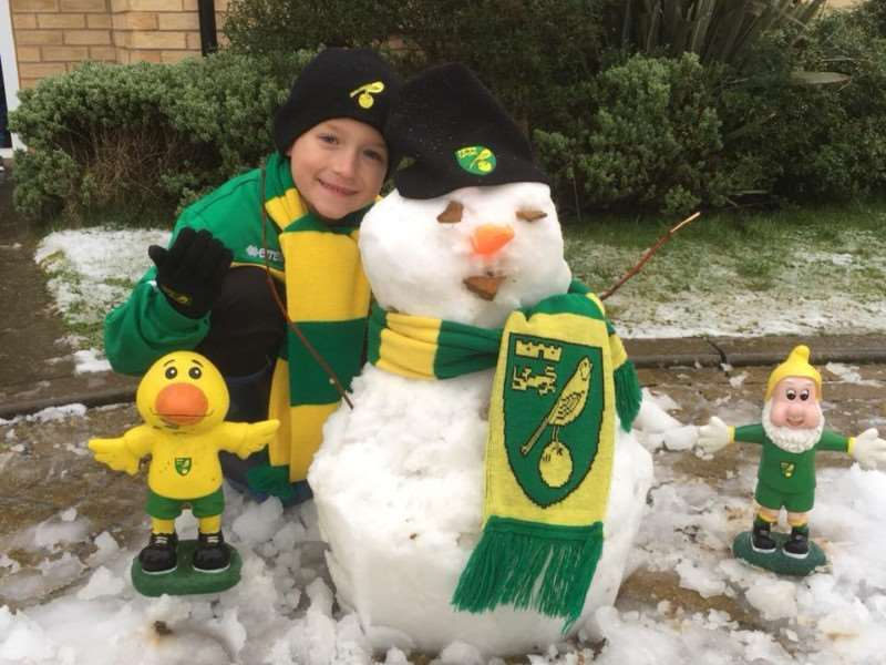 Hannah Billinghurst took this picture of her son with his Norwich City FC snowman.