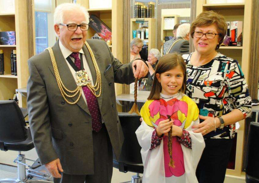 Niamh Rush, supported by grandad and Boston mayor Coun Brian Rush, with Niamh's grandmother and mayoress Jayne Rush. Photo supplied by Boston Borough Council.