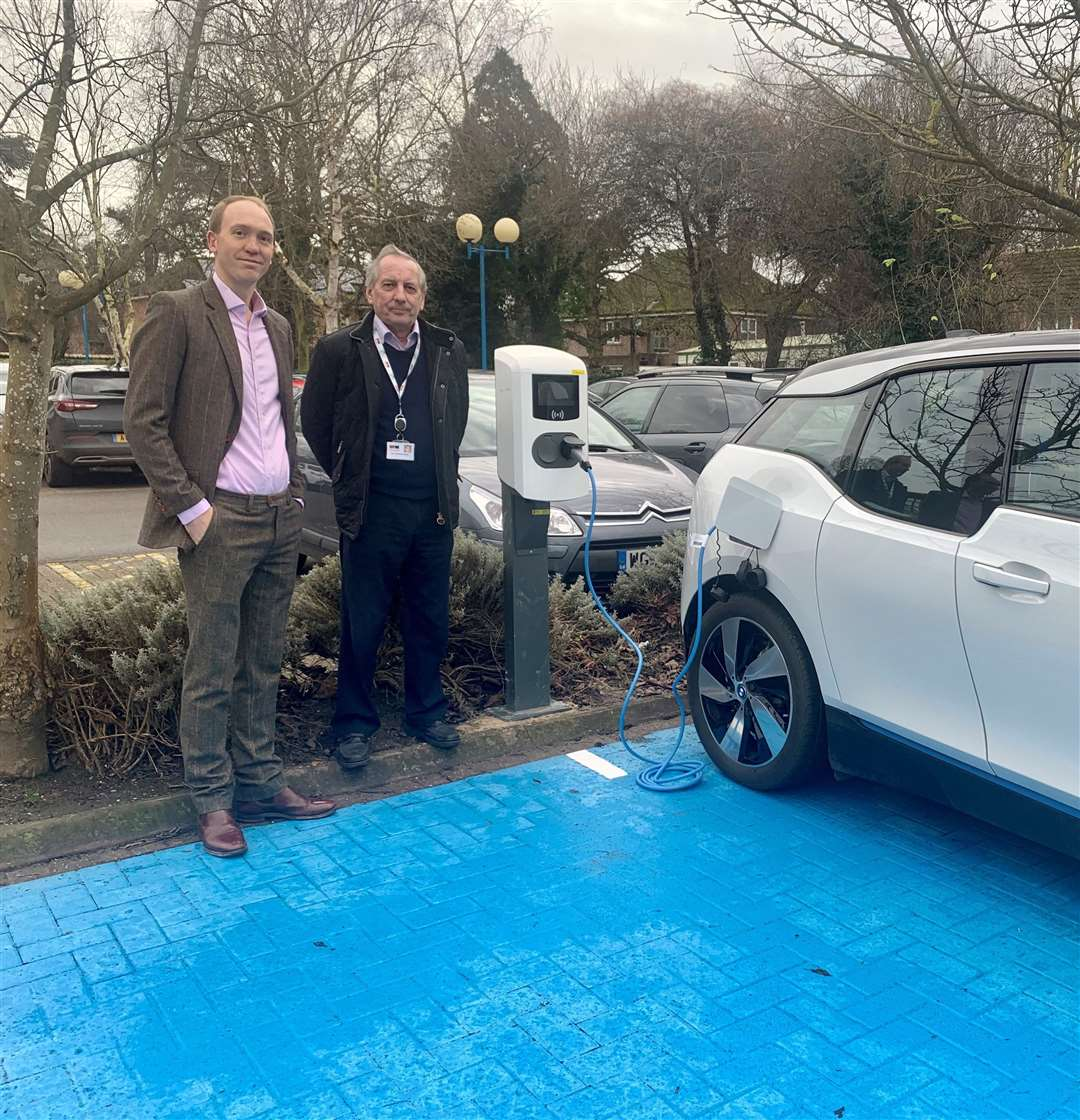 Councillor Anthony Casson, South Holland District Council; Sam Illsley, Vattenfall with one of the new charging points at Priory Road. (26381736)