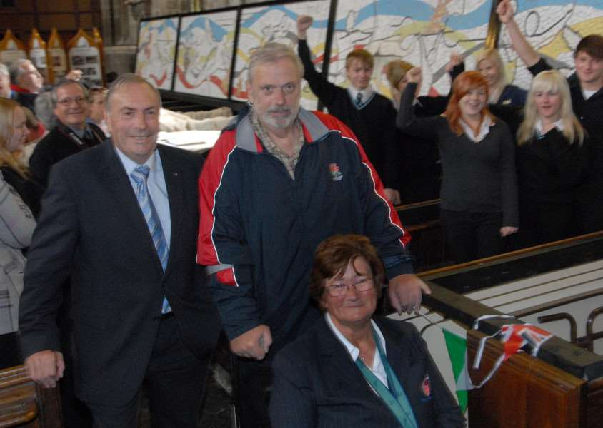 COACH AND MENTOR: Geoff Capes with Stuart Storey and Sally Reddin at University Academy Holbeach where commemorative mosaics were unveiled for the London 2012 Olympics. 'Photo by Tim Wilson. SG040712-244TW. www.spaldingtoday .co.uk/buyaphoto