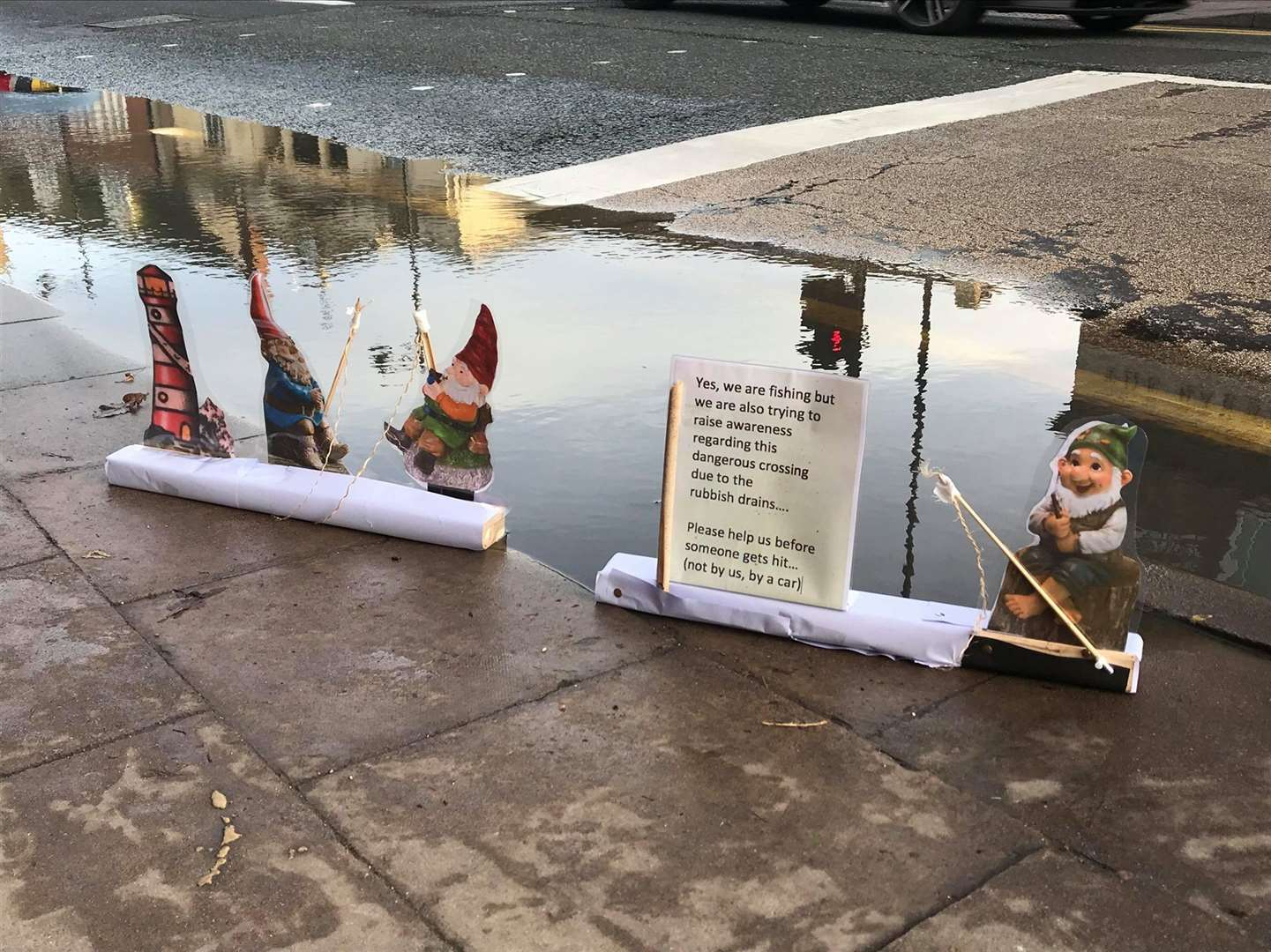 Lee Black has put these gnomes to highlight the dangers this puddle is creating in South Street, Bourne (26878239)