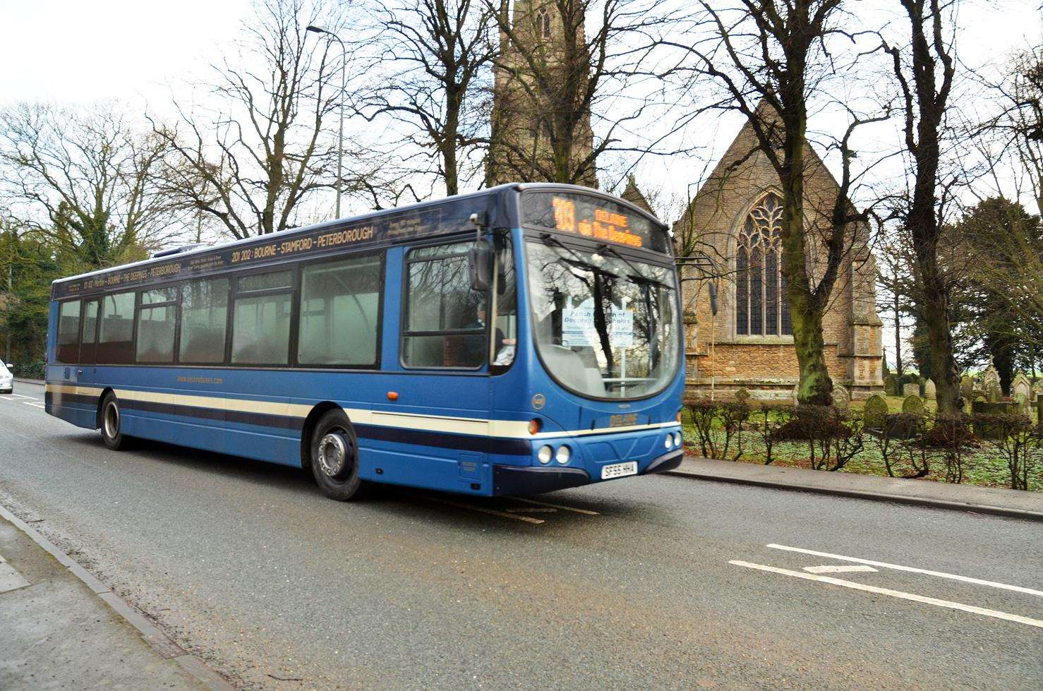 The new 203 Spalding to Stamford bus service passes by Deeping St Nicholas Parish Church. Photo (TIM WILSON): SG-250119-009TW.
