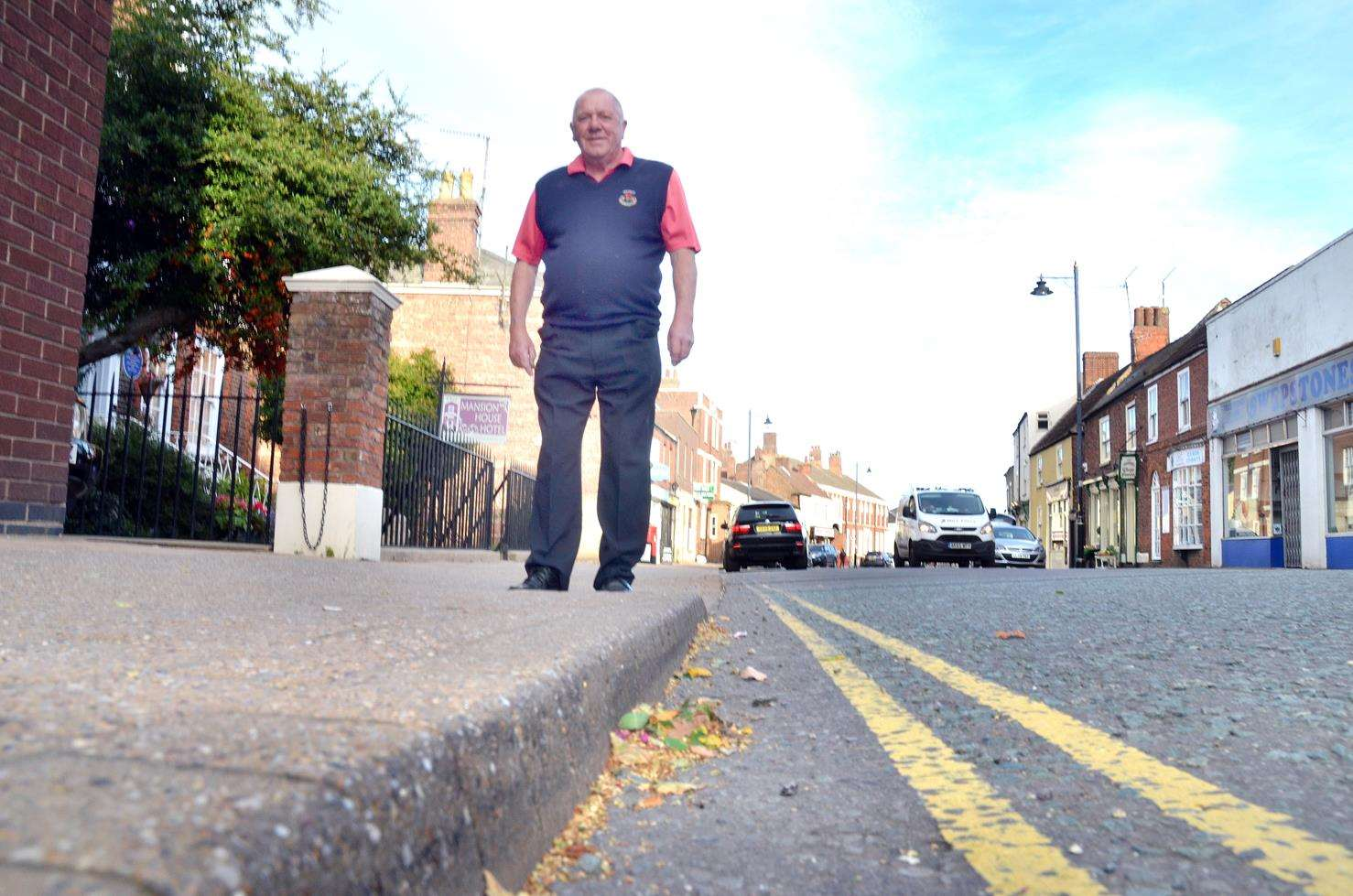 Graham Rudkin is unhappy about council street cleaning in Holbeach. Photo (TIM WILSON): 021018-4