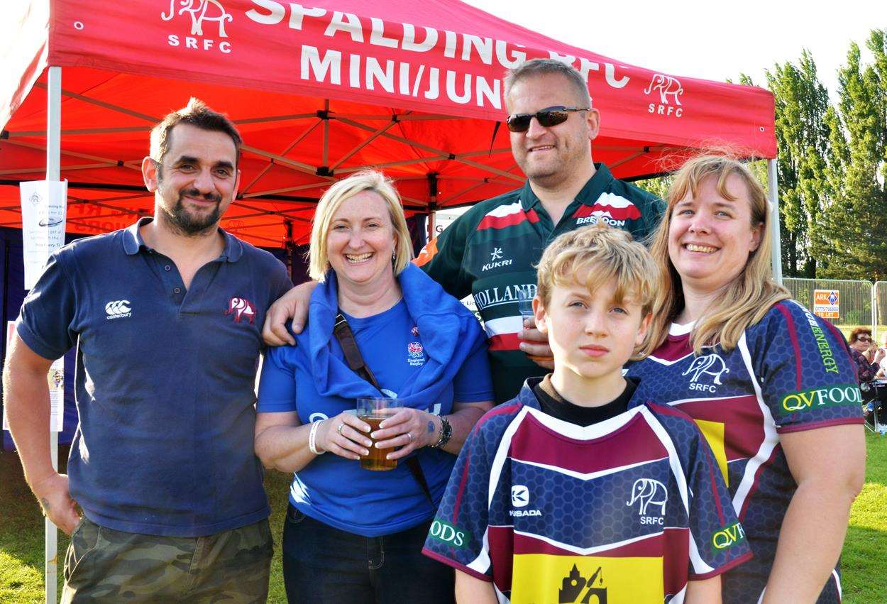 Richard Cooke, first team captain of Spalding Rugby Club who looks after the target practice stall where people could win a trip to watch a game of rugby sevens at Twickenham, with Alison and Kevin Hudson, Peppa and Evan Saunders. Photo by Tim Wilson.