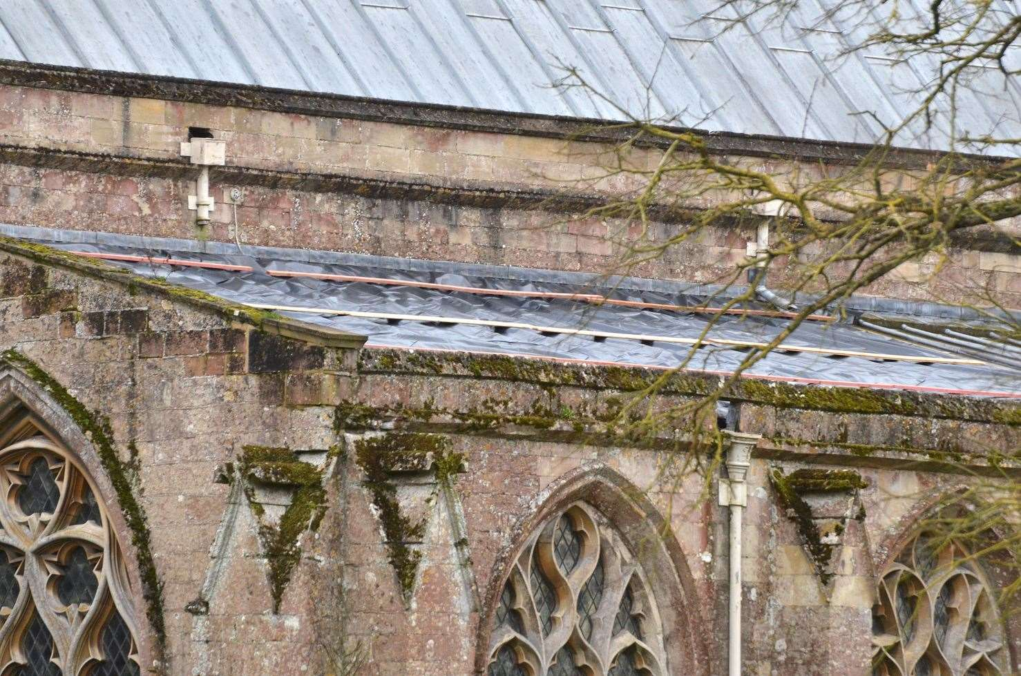 The lower roof to the north aisle was stripped by lead thieves