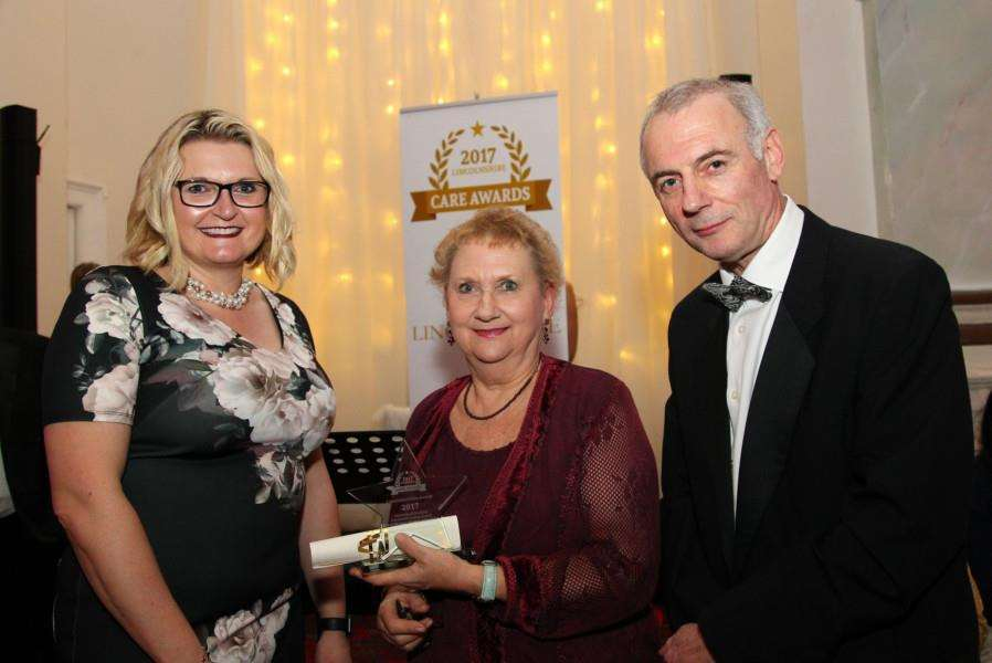 Stephanie Hewat-Jaboor received her award from Glen Garrod, Executive Director of Adult Care and Community Wellbeing at Lincolnshire County Council, and award sponsor Dr Sharon Black from the University of Lincoln