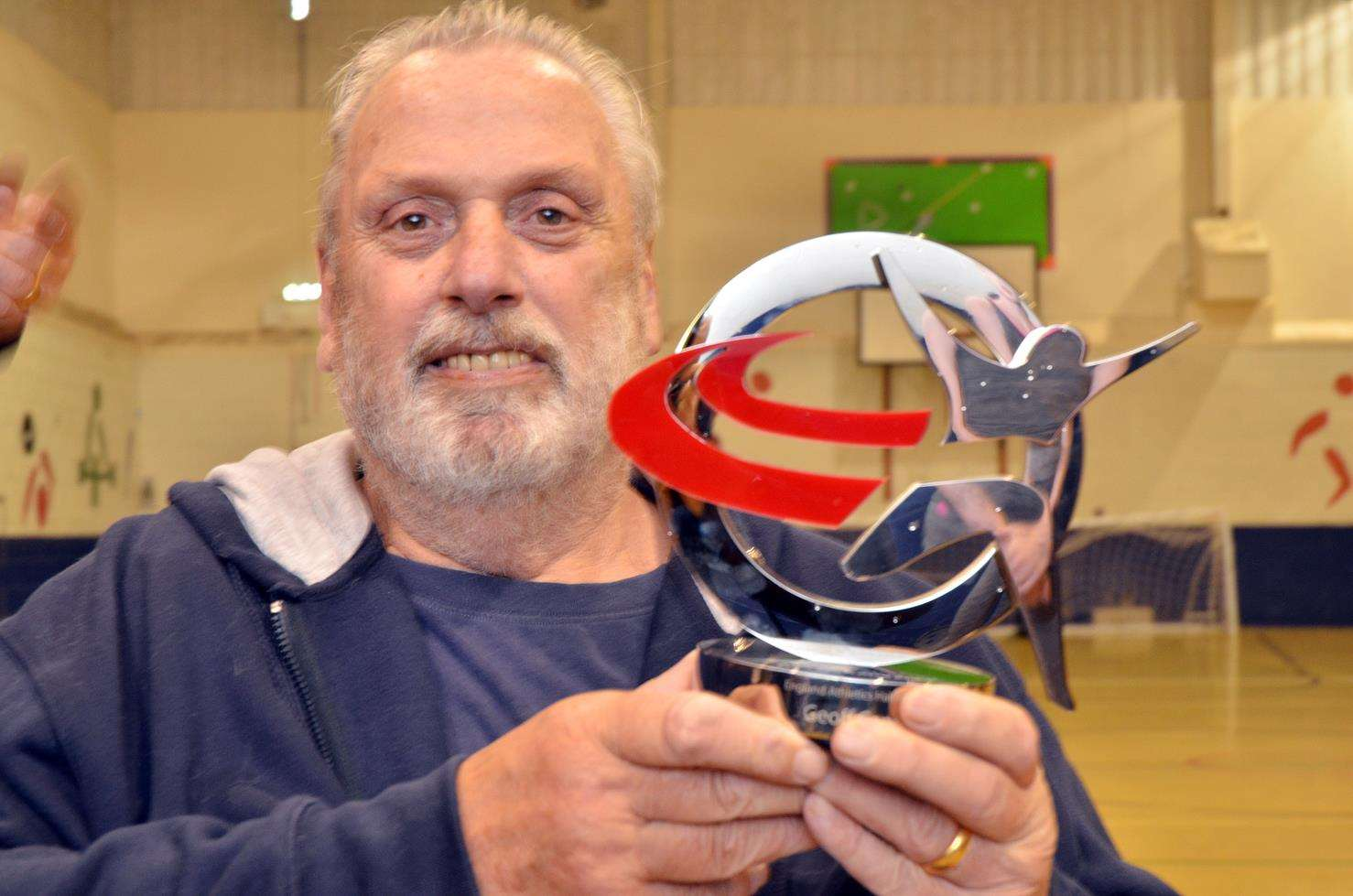 Geoff Capes proudly shows off his England Athletics hall of fame award