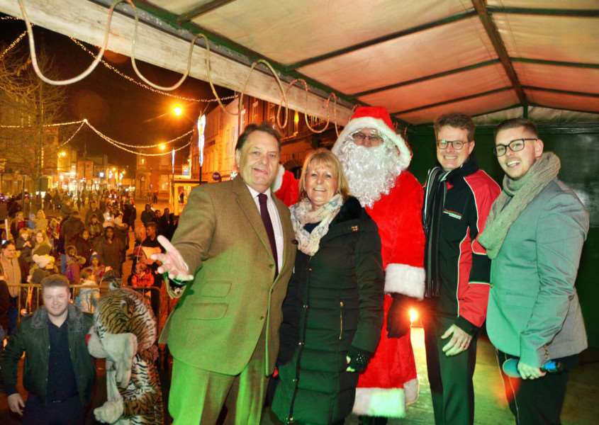 MP John Hayes, Jan Whitbourn, Rotary's Santa Claus, Andy Molsom and Niall Dignall on stage after the big countdown to the Christmas lights switch-on. SG021217-205TW