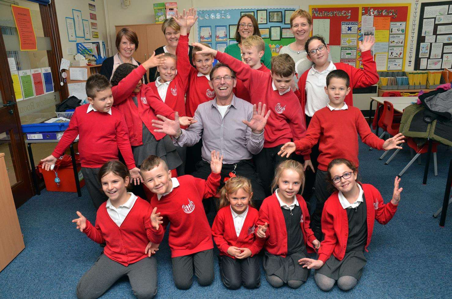 George with pupils and staff at William Stukeley C of E Primary School. (5530121)