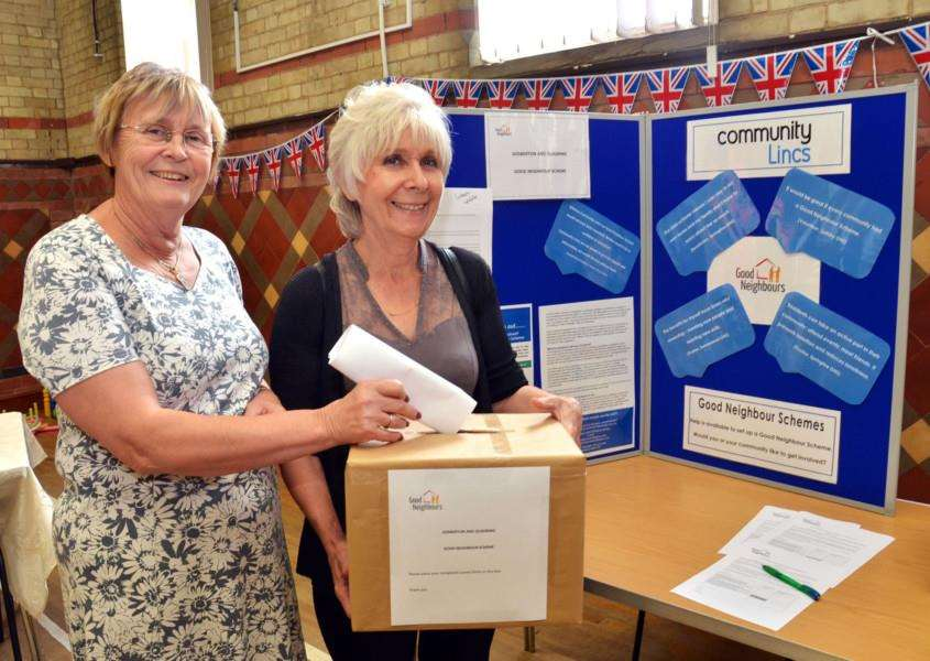 Sue Barker and Jane Brigginshaw publicising the Good Neighbour Scheme at Gosberton Public Hall last August. Photo (TIM WILSON): SG200817-125TW