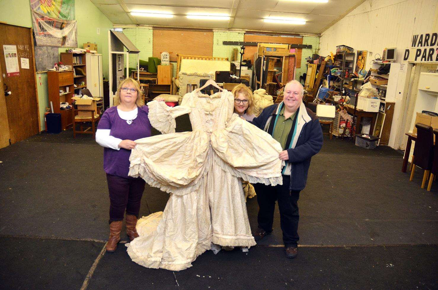 Melissa Brooks, Jodie Schweikhardt and Paul Coleman with a Victorian costume from the early days of SADOS.