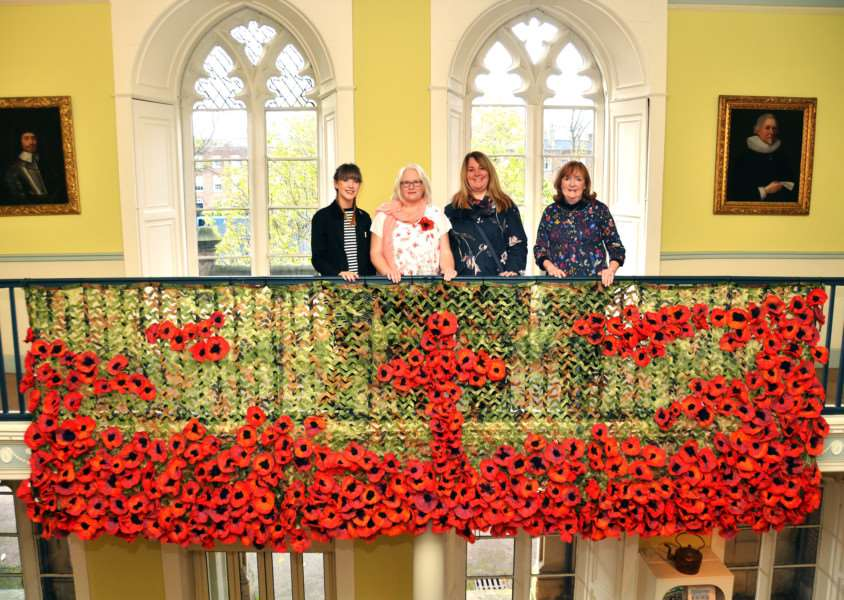 School teaching assistant Courtney Bell, artist Dawn Allen, Gail Bell and sponsor Coun Elizabeth Sneath, with the felted poppies display at Ayscoughfee Hall in Spalding. (SG211017-194TW).