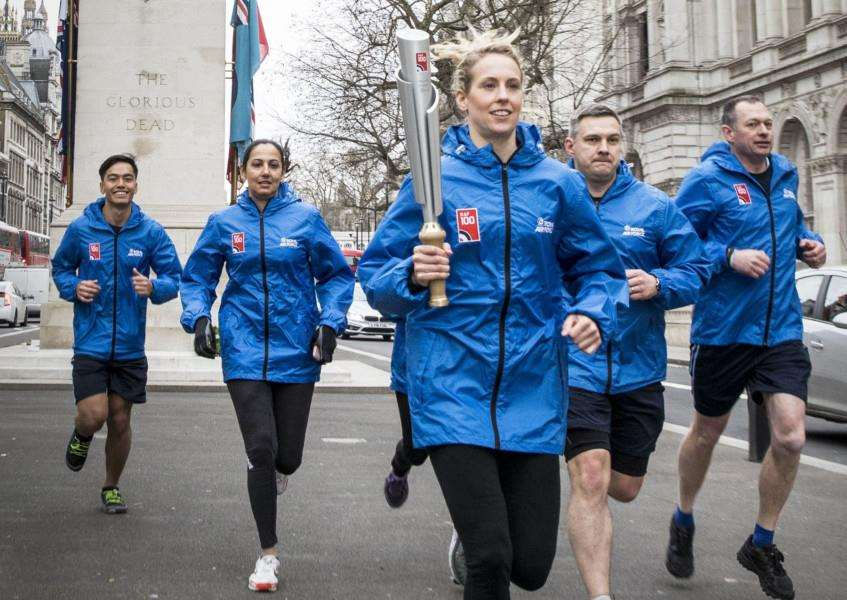 BATON RELAY: Flt Lt Lucy Nell carries the RAF100 Centenary Baton past the Cenotaph at the start of its journey across the UK. Photo by Senior Aircraftman Nicholas Egan.