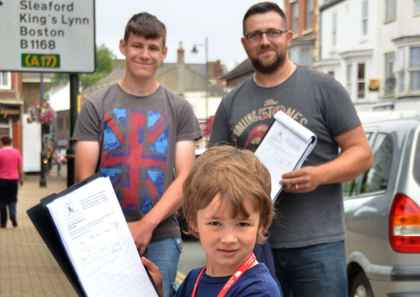 PEOPLE POWER: Oliver Taylor (front) with brother Harvey and dad Dad in Holbeach last September 2016 with their petition to save children's heart services at Glenfield Hospital. Photo: SG030916-104TW.
