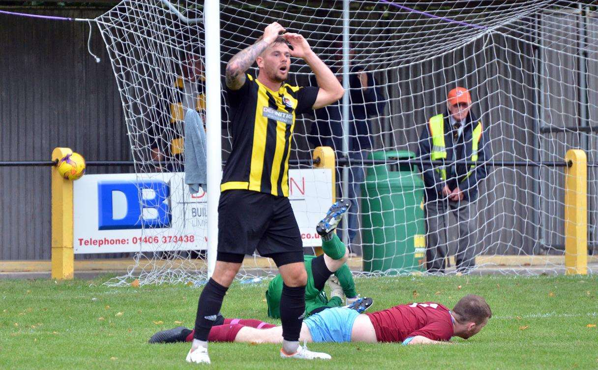 Josh Ford couldn't believe it when Deeping keeper Richard Stainsby produced a superb second-half save on Saturday. Photos: TIM WILSON