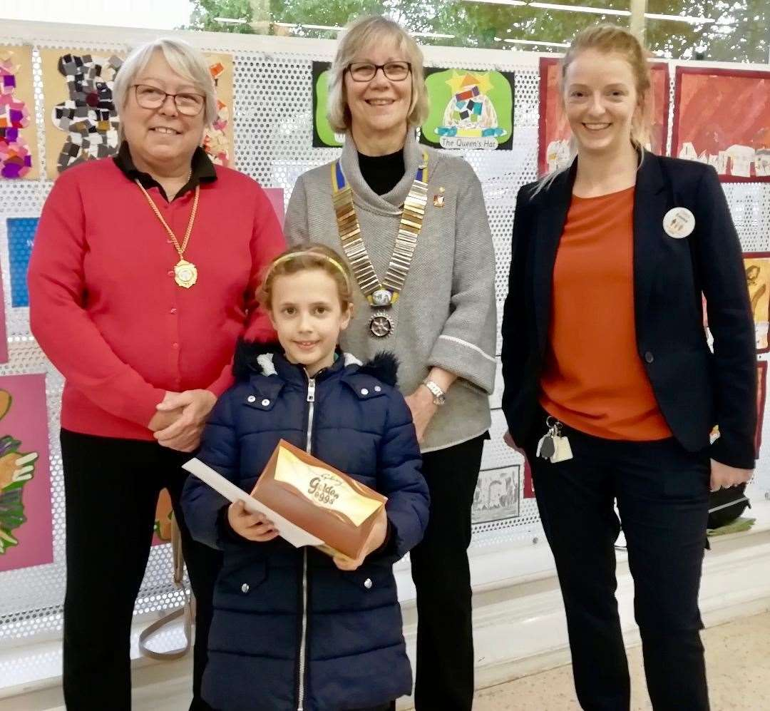 Key Stage One winner Jasmine Sutton of Deeping St James Primary School, with, from left, Counciilor Xan Collins, Rotary President Jenny Spratt and Emma Ward of Tesco. (10664250)