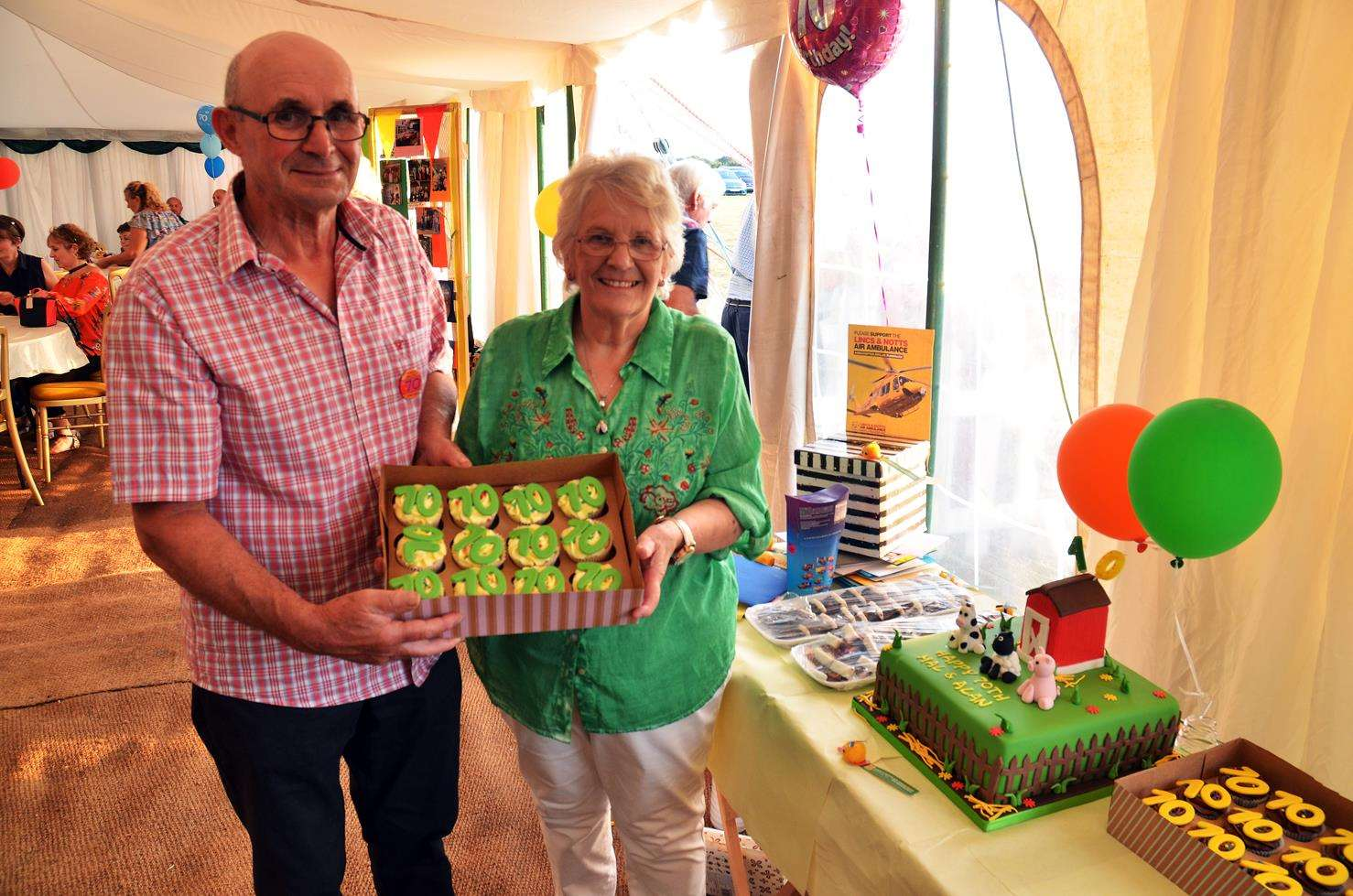 Eric and Marilyn Collishaw with one of the 70th birthday cakes made for them. Photo by Tim Wilson. 070718188SG.