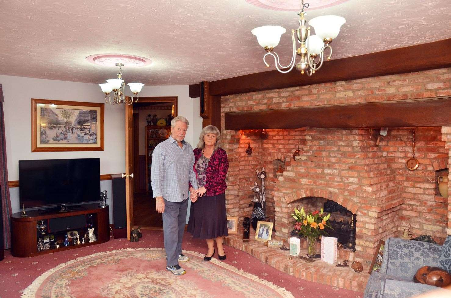 Catherine and Frank beside their amazing inglenook fireplace ...