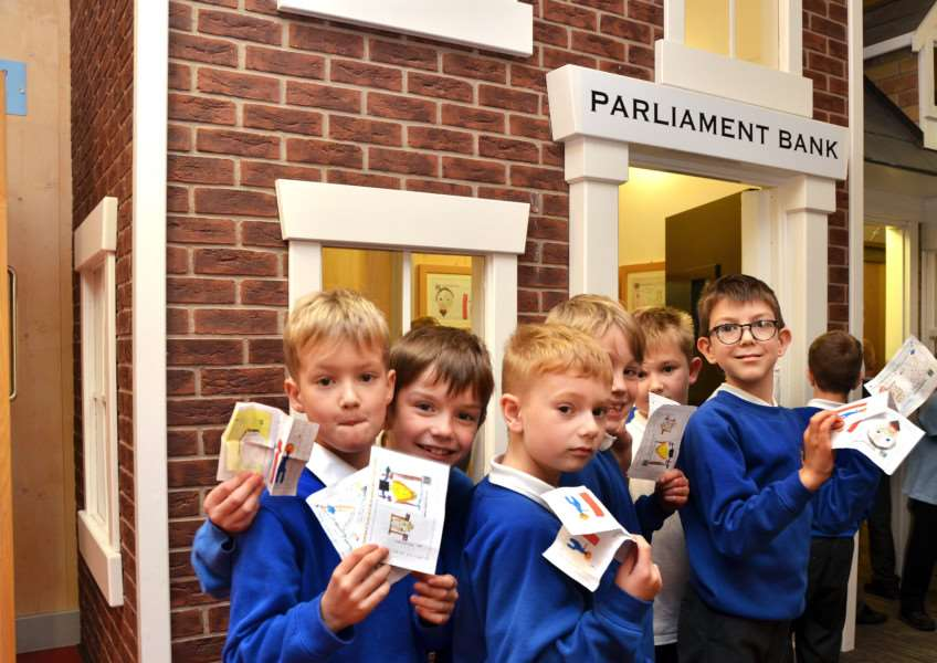 Children outside Parliament Bank at Kirton Primary School, ready to pay in their 'Kirts'. (SG161117-112TW)