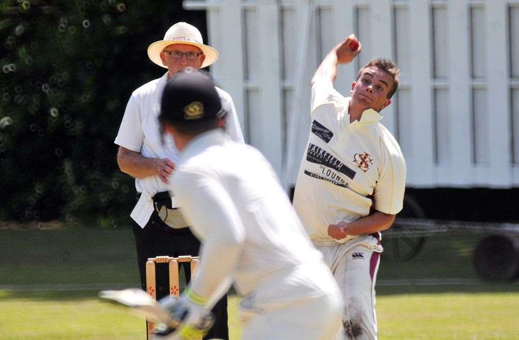 Long Sutton's Dan Oldfield bowls to Bourne's Robert Dunn.