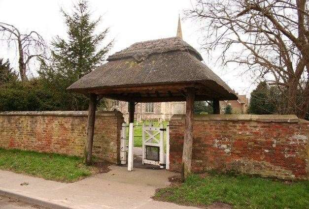 The thatched gateway outside Fleet Parish Church.Photo by Richard Croft. (14328936)