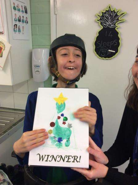 Garth School pupil Zuzanna with her winning card.