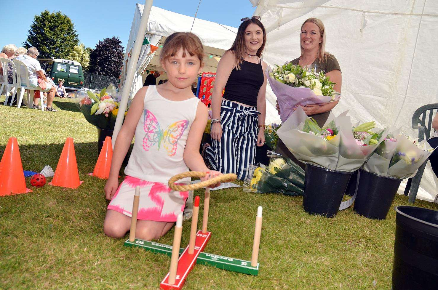 This year's Holbeach Food Festival at Carter's Park where Ruby Dewhirst, Abbey and Kelly Wilson are at the Friends of Holbeach Parks stand. Photo by Tim Wilson. 300618147SG
