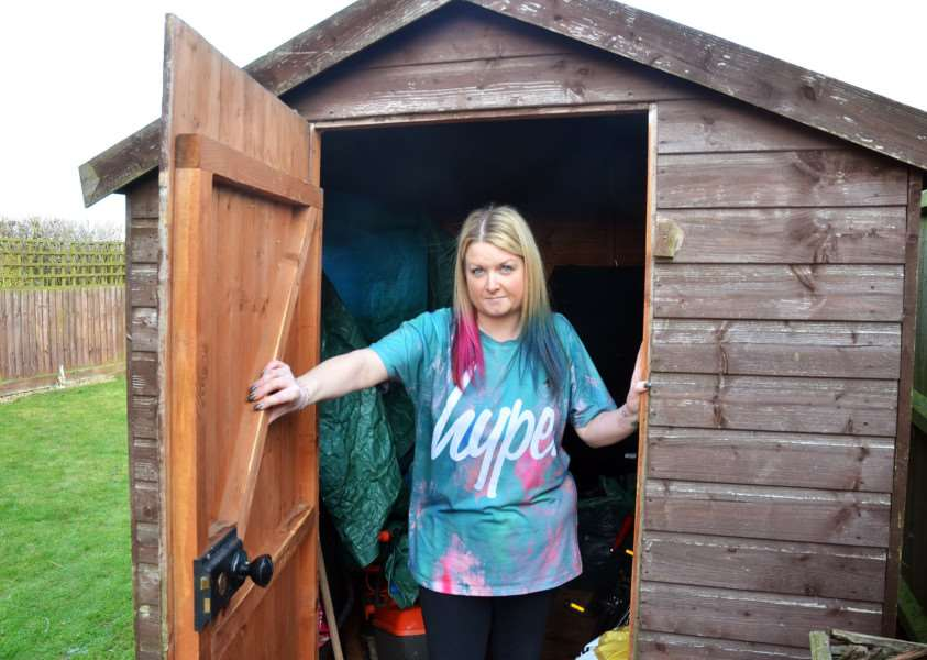 Katie Kirby with the shed that was broken into. (SG301118-151TW)