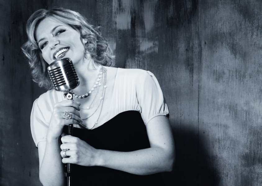 Singer Clare Teal performs Ella Fitzgerald favourites at the show including 'I Get a Kick Out of You' and 'Let's Do It, Let's Fall in Love.'