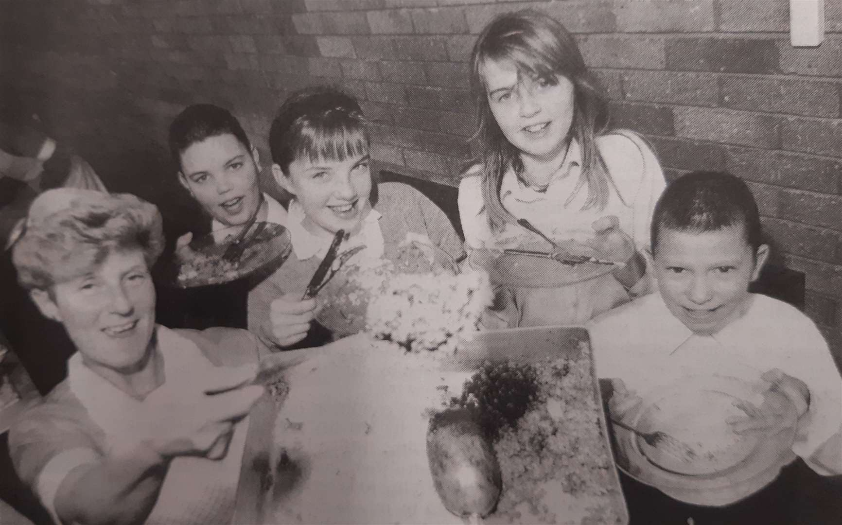 Catering assistant Pat Kirby serves up haggis to, from left, Shaun Morley (13), Paula Griffin (11), Paula Seaton (11) and Martyn Johnson (12). (44156410)