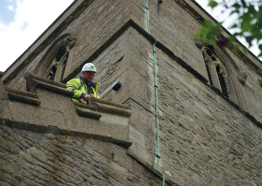 An alarm fitter from Donington firm GBSG Ltd working to protect one of our churches.